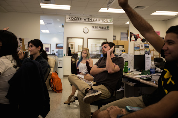 Editors at Ka Leo O Hawaiʻi vote on ideas for the cover of a recent weekly print issue.